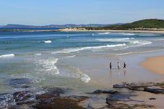 Charming seaside with three women Stock Photos