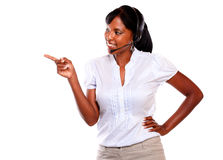 Charming secretary or telephone operator pointing Stock Photos