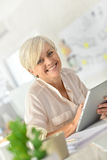 Charming senior businesswoman using tablet Royalty Free Stock Images