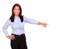 Charming senior woman pointing to her left Stock Image