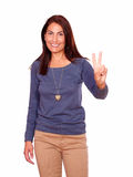 Charming senior woman showing you victory sign Stock Photography
