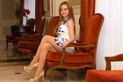 Charming sexy woman sitting on chair Royalty Free Stock Photos