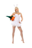 Charming sexy young blonde. With a carrot Royalty Free Stock Photography