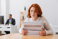 Charming sincere lady impressed with the workload Stock Photos