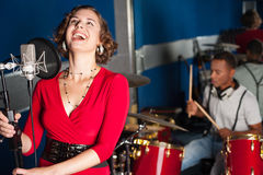 Charming singer recording her new track royalty free stock image