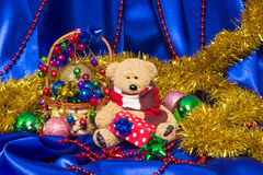 Charming small teddy bear with Christmas gift Stock Photography