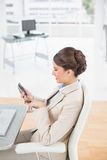 Charming smart brown haired businesswoman using a mobile phone Stock Photo