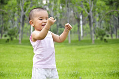 A charming smile. Of chinese baby Stock Photos