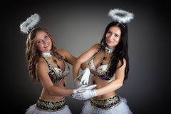 Charming smiling belly dancers posing at camera Stock Photos