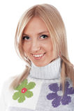 The charming smiling blonde in a sweater with flow Stock Image