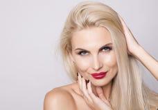Charming smiling blonde woman Stock Photos
