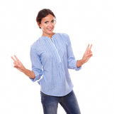Charming smiling brunette with winning sign Royalty Free Stock Photo