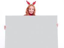 Charming smiling girl holding blank paper sheet Imágenes de archivo libres de regalías