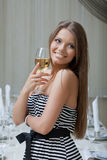 Charming smiling girl posing with glass of wine Royalty Free Stock Photos