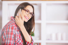 Charming smiling woman on phone Stock Images