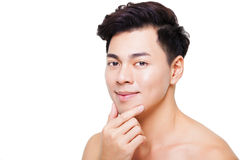 Charming and smiling young man face. Closeup charming and smiling young man face Stock Photos