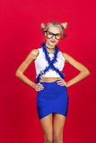 Charming smiling young woman in funny glasses blue skirt with bl Stock Image