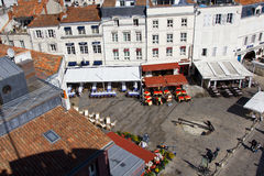 Charming square - La Rochelle. Charming square with a very big ancient anchor in La Rochelle harbour (in France) near the Tour de la Chaine Stock Photos