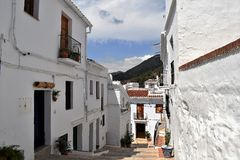 Charming and steep footpath in Frigiliana, Spanish white village Andalusia. Beautiful and charming with its narrow streets and footpaths white village Frigiliana Royalty Free Stock Photos