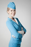 Charming Stewardess In Blue Uniform On Gray Background Stock Images