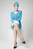 Charming Stewardess In Blue Uniform On Gray Background Royalty Free Stock Image