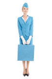 Charming Stewardess In Blue Uniform And Suitcase On Whit Stock Photography