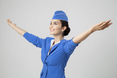 Charming Stewardess Dressed In Blue Uniform Stock Images