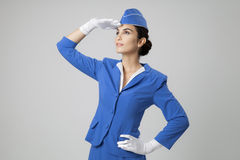 Charming Stewardess Dressed In Blue Uniform Royalty Free Stock Photos