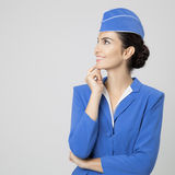 Charming Stewardess Dressed In Blue Uniform Royalty Free Stock Images