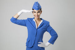 Charming Stewardess Dressed In Blue Uniform Stock Photo