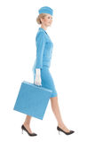 Charming Stewardess Dressed In Blue Uniform And Suitcase On White Stock Photo