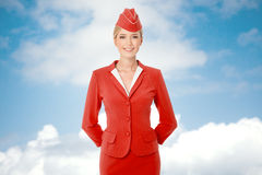 Charming Stewardess Dressed In Red Uniform. Royalty Free Stock Image