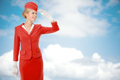Charming Stewardess Dressed In Red Uniform. Royalty Free Stock Images