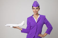 Charming Stewardess Holding Airplane In Hand. Stock Photos