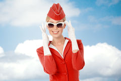 Charming Stewardess In Red Uniform And Vintage Sunglasses Stock Photos
