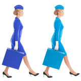 Charming Stewardess In Uniform With Suitcase. Color Variants Stock Photography