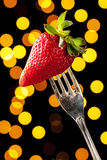 Charming Strawberry on a Silver Fork Royalty Free Stock Photography