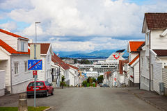 Charming street with a cruise ships in the background. Royalty Free Stock Photos