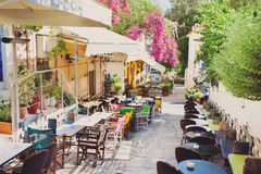 Charming street in the old district of Plaka in Athens, Greece. Beautiful street with cafe tables in Athens, Greece Stock Photography