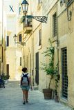 Charming street in old historic town of Lecce, Puglia, Italy. Lecce, Italy - July 21 2016: Charming street in old historic town of Lecce, Puglia, Italy royalty free stock photo
