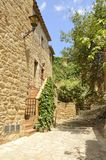 Charming street  in Pals. Charming street  in the medieval village of Pals, located in the middle of the Emporda region of Girona, Catalonia, Spain Stock Photos