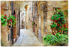 Charming streets of medieval towns, Spello ,Italy. Old charming streets of medieval towns, Spello ,Italy. artistic vintage picture stock images