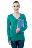 Charming student holding spiral notebook Royalty Free Stock Photography