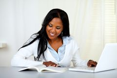 Charming student woman browsing a book Royalty Free Stock Photos
