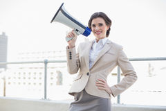 Charming stylish brown haired businesswoman holding a megaphone Stock Image