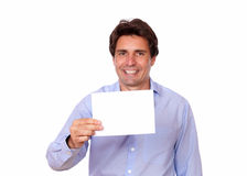 Charming stylish man holding a blank card Royalty Free Stock Image