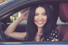 Happy woman sitting in a modern car stock images