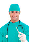Charming surgeon holding a scalpel Royalty Free Stock Photos