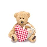 Charming teddy bear with fabric heart Royalty Free Stock Images