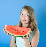 Charming teen girl with a big piece of watermelon. Royalty Free Stock Photo